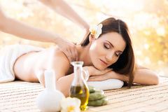 Young and beautiful girl relaxing in a spa salon Stock Photo