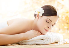 Young and beautiful girl relaxing in a spa salon Royalty Free Stock Image
