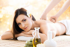 Young and beautiful girl relaxing in a spa salon Royalty Free Stock Photos