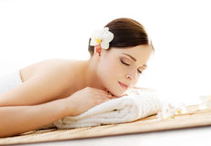 Young and beautiful girl relaxing in a spa salon Stock Images
