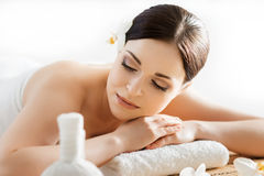 Young and beautiful girl relaxing in a spa salon Stock Photos