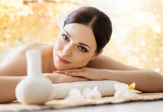 Young and beautiful girl relaxing in a spa salon Stock Photography