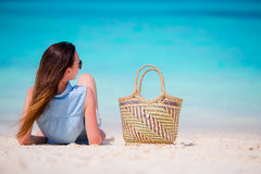 Young beautiful girl relaxing on white beach. Tourist woman enjoy beach vacation lying on the sand Stock Photos