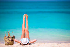 Young beautiful girl relaxing on white beach Royalty Free Stock Photography