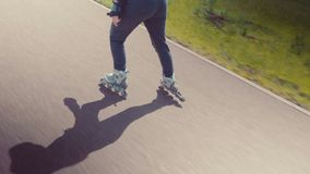 Young Beautiful Girl Rollerskating In A Park. Young Woman Rollerblading On A Beautiful Sunny Summer Day In A Park. stock footage