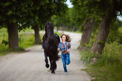 Young beautiful girl runs with the horse Royalty Free Stock Images