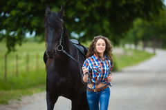 Young beautiful girl runs with the horse Royalty Free Stock Photo