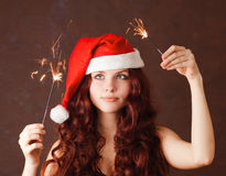 Young beautiful girl in Santa Claus hat Royalty Free Stock Photography