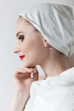 Young beautiful girl in the sauna towel Royalty Free Stock Image