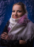 Young beautiful girl in a scarf for frozen glass Royalty Free Stock Photo