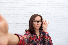 Young Beautiful Girl Seriuos Taking Selfie Picture Open Touch Glasses Smart Phone Photo Camera stock photography