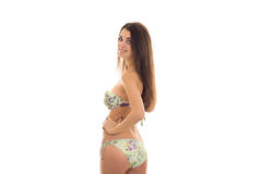 Young beautiful girl with sexy body in a swimsuit turned her back to the camera and smiling Royalty Free Stock Photo