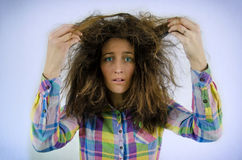 Disheveled. Young beautiful girl in a shirt with tousled hair Stock Photo
