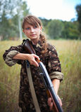 Young beautiful girl with a shotgun Stock Image