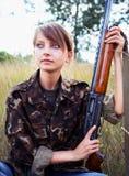 Young beautiful girl with a shotgun Stock Photo