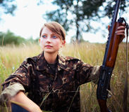 Young beautiful girl with a shotgun Stock Images