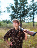 Young beautiful girl with a shotgun outdoor Stock Photo