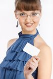 Young Beautiful Girl Shows A Business Card Royalty Free Stock Photo
