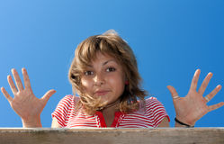 Young beautiful girl shows palm Royalty Free Stock Image
