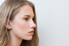 Young beautiful girl side view portrait on white background Royalty Free Stock Photo