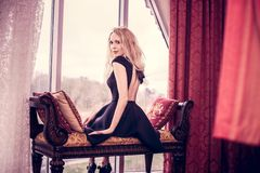 Young beautiful girl sit in a luxury room stock photos