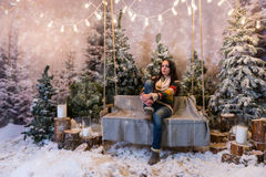 Young beautiful girl sitting on a bench or a swing above the fla Royalty Free Stock Image