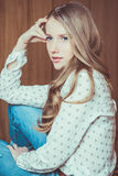 Young beautiful girl sitting on floor Royalty Free Stock Photos