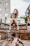 Young beautiful girl sitting on the old truck Stock Photo
