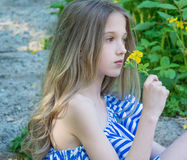Young beautiful girl sitting on the stairs in the park with flower, Stock Photos