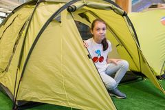 Young beautiful girl sitting in tourist tent stock photos