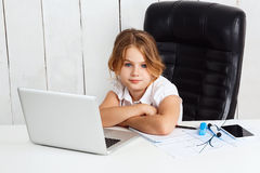 Young beautiful girl sitting at working place in office. Stock Photos