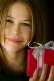 Young beautiful girl with a small gift box Stock Photos