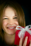 Young beautiful girl with a small gift box Stock Images