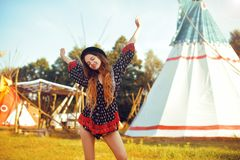 Young beautiful girl smiling on background teepee, tipi- native indian house. Pretty girl in hat with long cerly hair. In dress pouse. Travel in Western royalty free stock photos