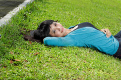 Young beautiful girl smiling and lying down Stock Photos