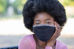 Free Young Beautiful Girl Smiling Wearing Protective Fabric Face Mask In Coronavirus Pandemic, COVID-19. Stock Images - 185982194
