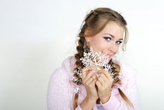 The young beautiful girl with a snowflake. In hands Stock Photos