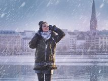 Young beautiful girl and snowing at Alster Lake in Hamburg city Royalty Free Stock Photos