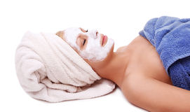Young beautiful girl with spa mask on face Royalty Free Stock Photos