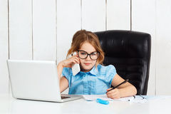 Young beautiful girl speaking phone at working place in office. Royalty Free Stock Photo