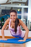 Young beautiful girl in sport hall Stock Photo