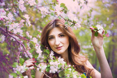 Young beautiful girl in spring garden Stock Photo