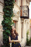 Young beautiful girl standing near the old beautiful building Royalty Free Stock Image