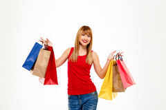 Young beautiful girl standing with purchases over white background. royalty free stock photo