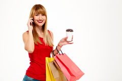 Young beautiful girl standing with purchases over white background. Stock Photo