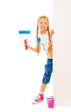 Young beautiful girl stands behind the corner Royalty Free Stock Image