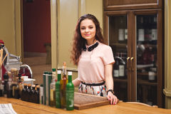 Young beautiful girl stands in kitchen in Italian style royalty free stock photos
