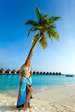 Young beautiful girl stands near by palm tree Stock Image