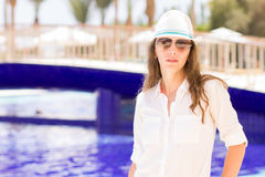 Young beautiful girl stands near the swimming pool Royalty Free Stock Image
