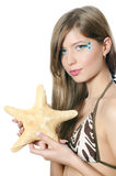 The young beautiful girl with a starfish Royalty Free Stock Image